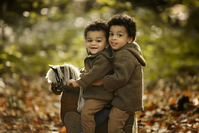 Bromley Autumn Sibling Photography | portrait of brothers on a rocking horse during autumn mini photoshoot