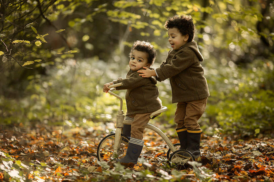 Bromley Autumn Sibling Photography | photo of siblings playing on an old bike during autumn mini photo session