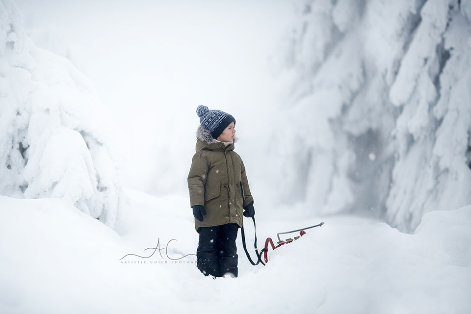 photo of a 5 year old boy gazing at the snowy mountains | London