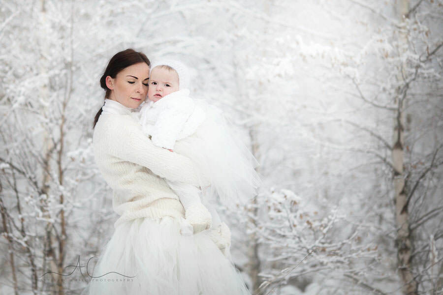 portrait of a mum and a baby girl taken with the winter trees background | London