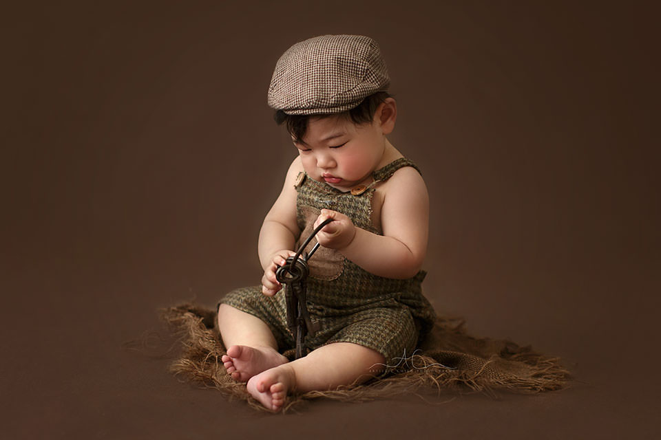 photo of a baby boy playing with large bunch of metal keys   South East London professional photo session