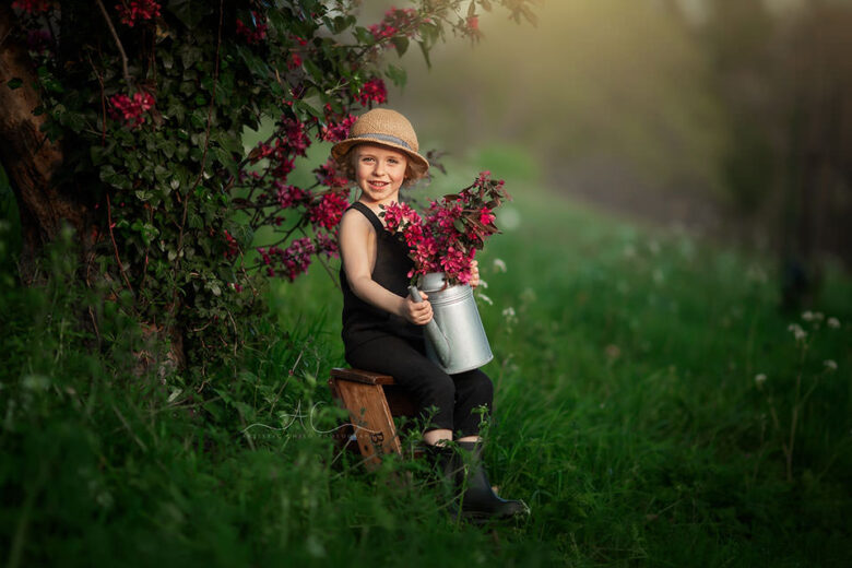 Top London Child Spring Photography | portrait of a 4 year old boy holding flowers