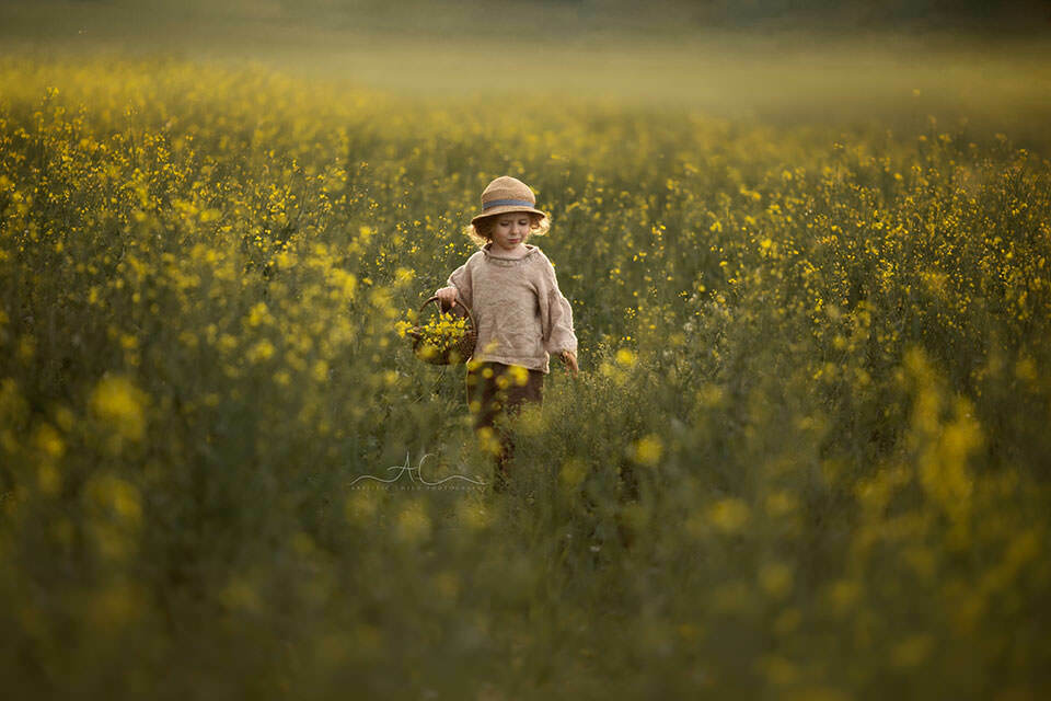 spring portrait of a 4 year old boy in rapeseed field   London