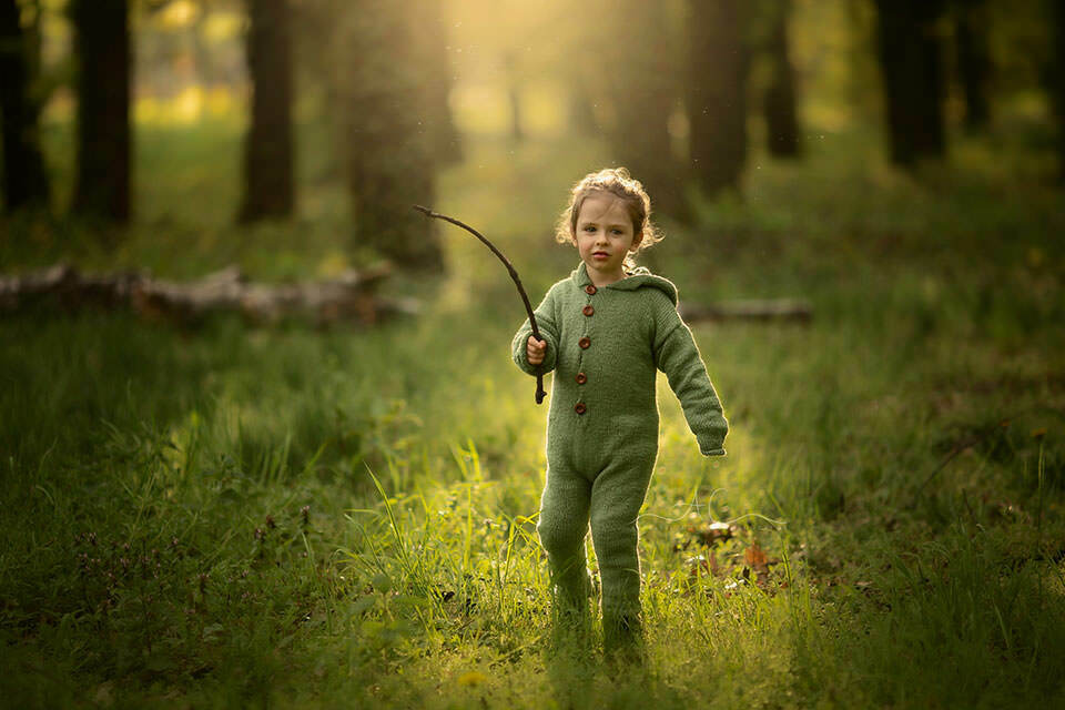 Spring South East London Child Photo Session   3 years old boy playing in woods with a stick