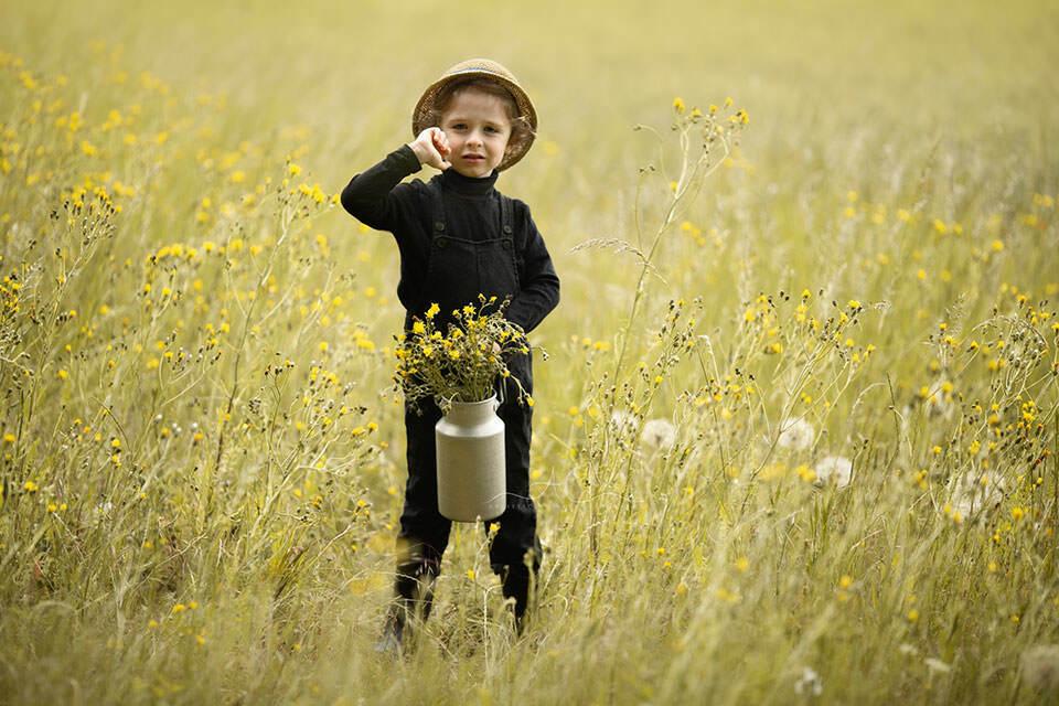 portrait of a 4 year old boy wearing a summer hat | London