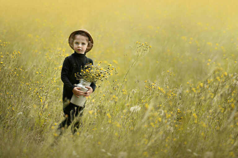 photo of a 4 year old boy with yellow flowers and a straw hat | London