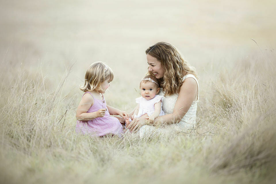 Mum plays with her daughters during a family photo session | Bromley